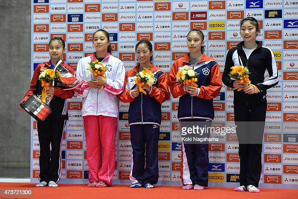Aiko Sugihara Natsumi Sasada Asuka Teramoto Sakura Yumoto and Yuki Uchiyama pose for a photograph during the Artistic Gymnastics NHK Trophy at Yoyogi...