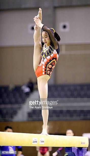 Aiko Sugihara of Japan competes in the Balance Beam during day two of the Toyota International Gymnastics Competition at Sky Hall Toyota on December...