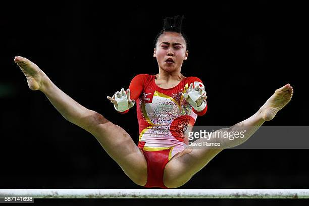 Aiko Sugihara of Japan competes on the uneven bars during Women's qualification for Artistic Gymnastics on Day 2 of the Rio 2016 Olympic Games at the...