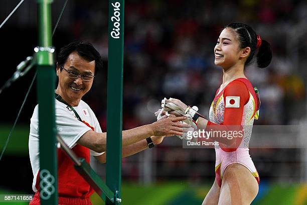 Aiko Sugihara of Japan is congratulated by her coach after competing on the uneven bars during Women's qualification for Artistic Gymnastics on Day 2...