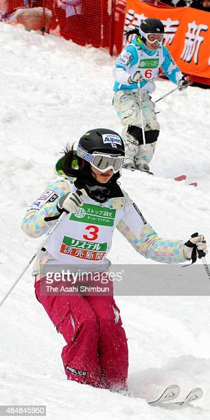 Aiko Uemura and Miki Ito of Japan compete in the Women's Dual Mogul final during the FIS Frestyle World Championships at Listel Inawashiro on March 8...