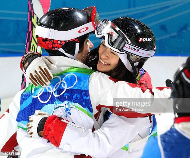 Aiko Uemura of Japan hugs with silver medalist Jennifer Heil of Canada after the women's freestyle skiing moguls during the Vancouver 2010 Winter...