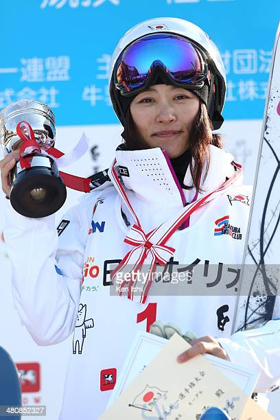 Aiko Uemura of Japan poses for photos with her trophy at podium after winning the competition during the Women's Finals of the All Japan Freestyle...