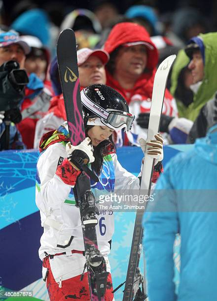 Aiko Uemura of Japan reacts after she missed medals during the women's freestyle skiing moguls during the Vancouver 2010 Winter Olympics at Cypress...
