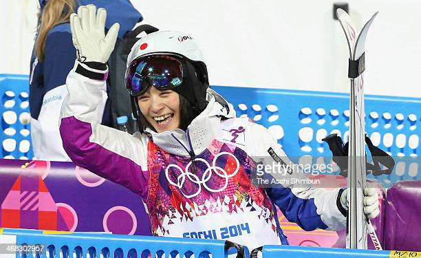 Aiko Uemura of Japan smiles and waves after placing 4th in the Ladies' Moguls Final on day one of the Sochi 2014 Winter Olympics at Rosa Khutor...
