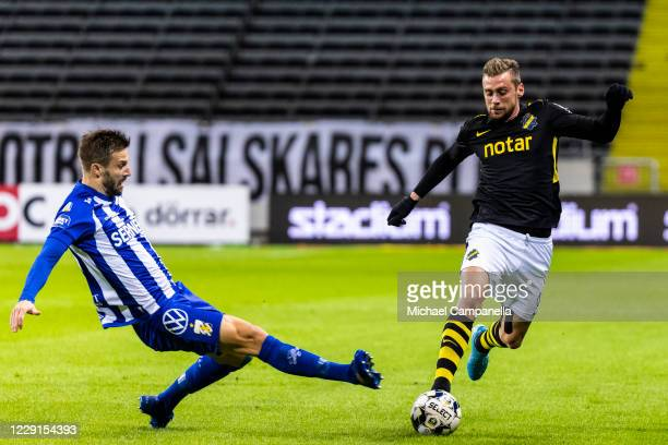 AIKs Filip Rogic is tackled by Mattias Bjarsmyr of IFK Goteborg during the Allsvenskan match between AIK and IFK Goteborg at Friends Arena on October...