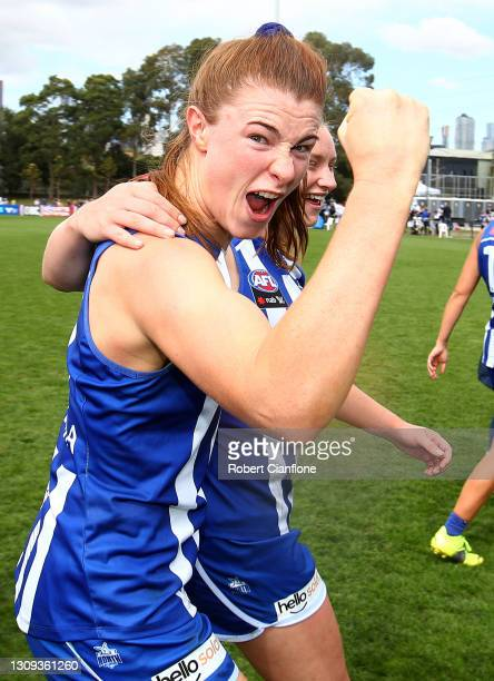 Aileen Gilroy of the Kangaroos celebrates after the Kangaroos defeated the Dockers during the round 9 AFLW match between the North Melbourne...