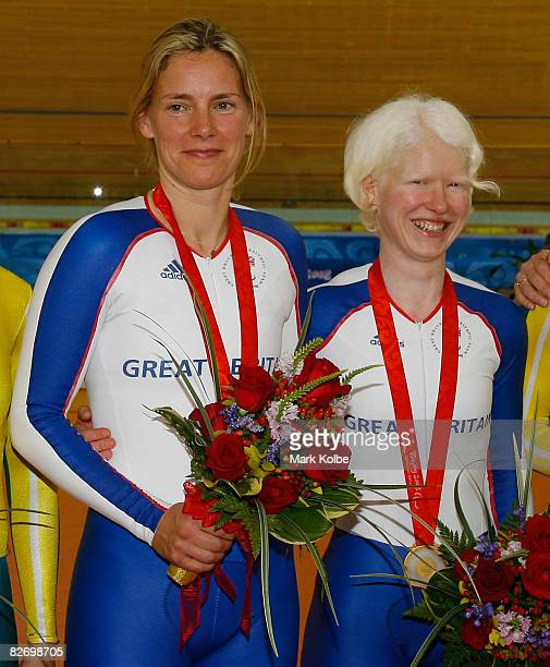 Aileen McGlynn and her pilot rider Ellen Hunter of Great Britain celebrate with their gold medals after winning the women's 1KM Time Trial in the...
