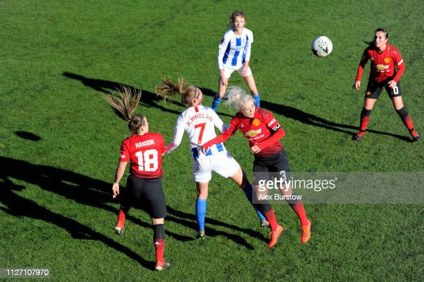 Aileen Whelan of Brighton Hove Albion battles for possession with Alex Greenwood and Kirsty Hanson of Manchester United during the SSE Women's FA Cup...