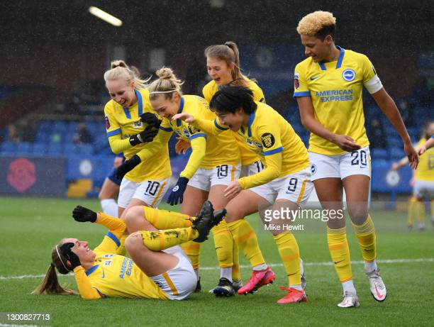 Aileen Whelan of Brighton & Hove Albion celebrates with team mates after scoring their side's first goal during the Barclays FA Women's Super League...