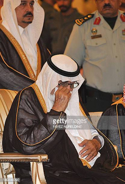 Ailing Saudi King Abdullah bin Abdel Aziz wears a surgical mask and wipes a tear as he prays during the funeral of his brother the late Saudi Crown...