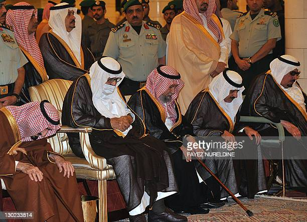 Ailing Saudi King Abdullah bin Abdel Aziz wears a surgical mask as he prays alongside family members during the funeral of his brother the late Saudi...