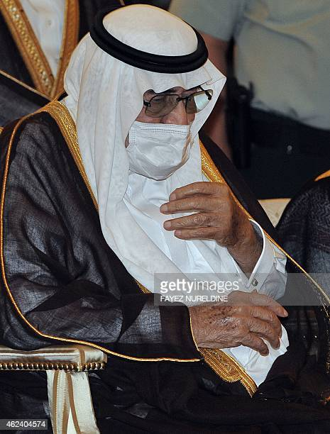 Ailing Saudi King Abdullah bin Abdel Aziz wears a surgical mask as he prays during the funeral of his brother the late Saudi Crown Prince Sultan bin...