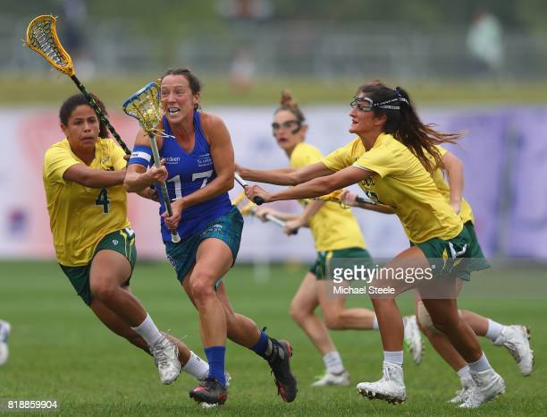 Ailsa Stott of Scotland is challenged by Theadora Kwas and Stella Justice Allen of Australia during the quarter final match between Australia and...