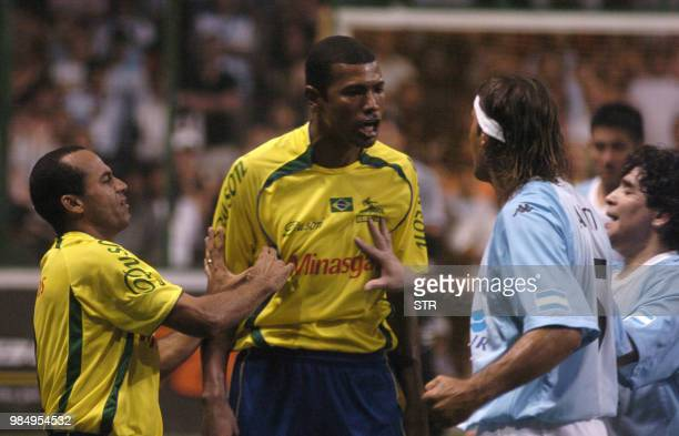 Ailton and Junior Bahiano of Brazil argue with Gabriel Amato and Diego Maradona of Argentina during their friendly Showbol match at the Luna Park...