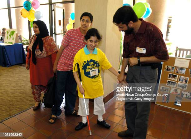 ANGELES Aiman Masood is congratulated by her father Masood Akhtar right brother Ahsan Masood and mother Nuzhat Masood after competing during The...