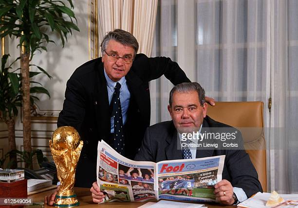 Aime Jacquet coach of the French soccer national team and Claude Simonet President of the French soccer federation in his office with the trophy of...