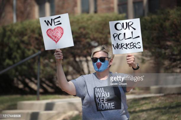 Aimee Aironimi shows her support for poll workers at a polling place at Riverside University High School on April 07 2020 in Milwaukee Wisconsin...
