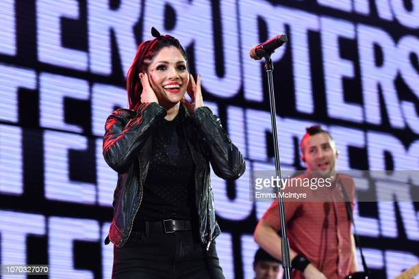 Aimee Allen and Justin Bivona of the band The Interrupters perform on stage during the KROQ Absolut Almost Acoustic Christmas at The Forum on...