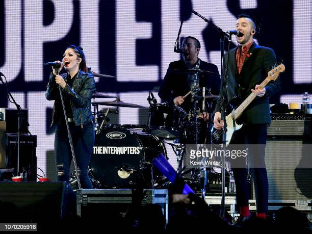 Aimee Allen Jesse Bivona and Justin Bivona of the band The Interrupters perform on stage during the KROQ Absolut Almost Acoustic Christmas at The...