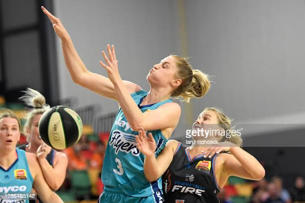 Aimee Clydesdale of the Flyers and Shyla Heal of the Fire compete for the ball during the round two WNBL match between the Southside Flyers and the...