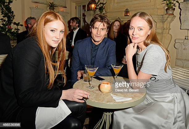 Aimee Croysdill Oliver Cheshire and Laura Haddock attend the Dior And I UK Premiere after party at Loulou's on March 16 2015 in London England