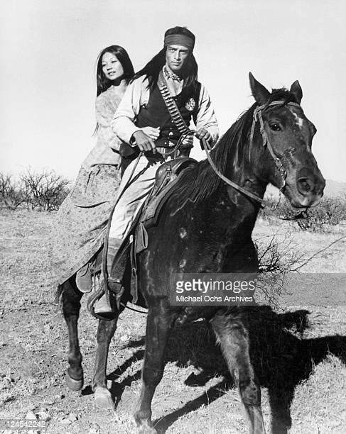 Aimee Eccles rides horseback with Jorge Luke in a scene from the film 'Ulzana's Raid' 1972