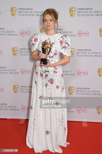 """Aimee Lou Wood, winner of the Best Female Comedy Performance award for her role in """"Sex Education"""", poses in the Winners Room at the Virgin Media..."""