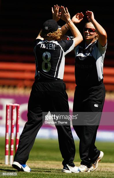 Aimee Mason of New Zealand celebrates with team mate Haidee Tiffen after claiming the wicket of Anjum Chopra of India during the ICC Women's World...