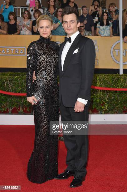 Aimee Mullins and actor Rupert Friend attend the 20th Annual Screen Actors Guild Awards at The Shrine Auditorium on January 18 2014 in Los Angeles...