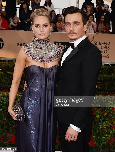 Aimee Mullins and actor Rupert Friend attend the 22nd Annual Screen Actors Guild Awards at The Shrine Auditorium on January 30 2016 in Los Angeles...