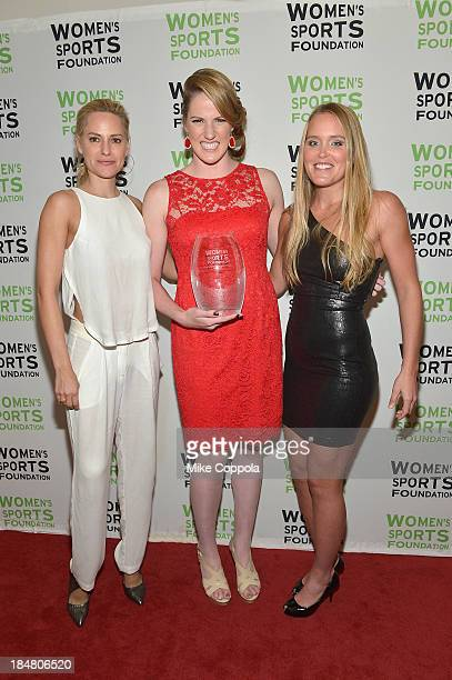 Aimee Mullins and Grete Eliassen pose with Olympic gold medalist Missy Franklin with the Individual Sports Woman of the Year Award during onstage...