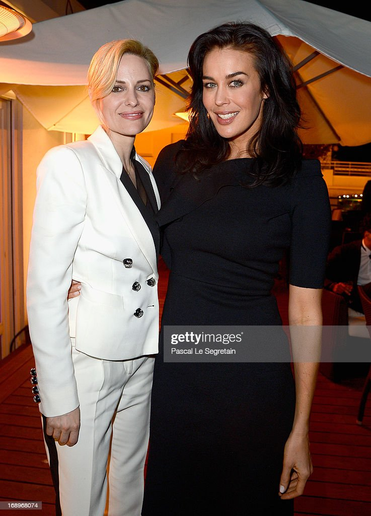 Aimee Mullins (L) and Megan Gale attend the L'Or Sunset Showcase with Micky Green for L'Oreal during The 66th Annual Cannes Film Festival at Hotel Martinez on May 17, 2013 in Cannes, France.