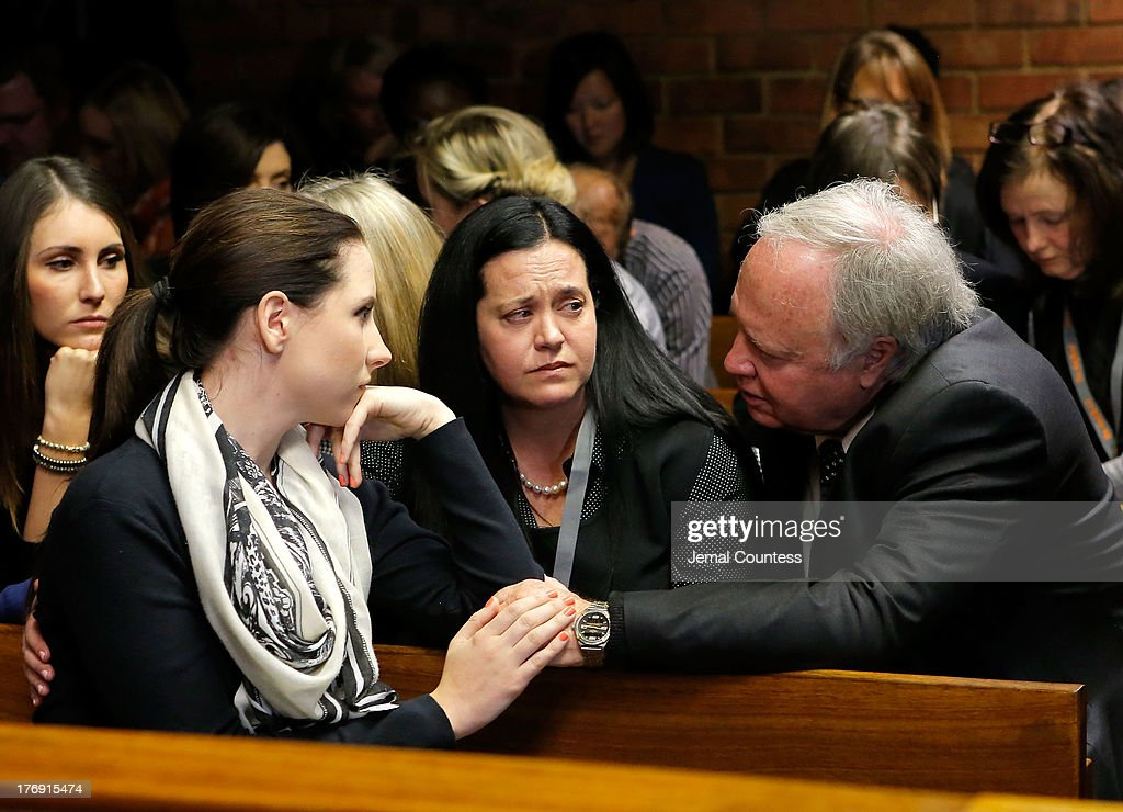 Aimee Pistorious (L) is comforted by Theo Pistorious (R) prior to the indictment hearing for South African athelete Oscar Pistorius at Pretoria Magistrates Court on August 19, 2013 in Pretoria, South Africa. Pistorius, 26 is accused of murdering his girlfriend Reeva Steenkamp which Pistorius denies claiming he mistook Steenkamp for an intruder. The indictment was served and the trial date of March 3, 2014 has now been set.