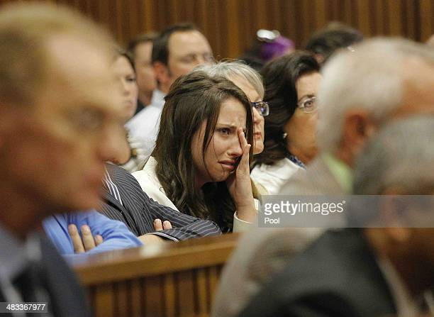Aimee Pistorius is overcome with emotion as she listens to her brother Oscar's testimony in the Pretoria High Court on April 8 in Pretoria, South...