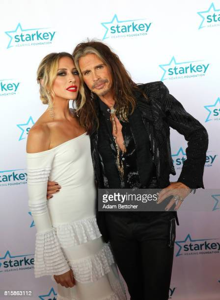 Aimee Preston and Steven Tyler pose on the red carpet at the 2017 Starkey Hearing Foundation So the World May Hear Awards Gala at the Saint Paul...