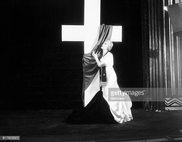 Aimee Semple McPherson celebrates her 25th anniversary as an evangelist by participating in an elaborate pageant at the Angelus Temple in Los...