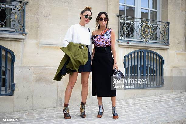 Aimee Song and a guest attend the Christian Dior show as part of the Paris Fashion Week Womenswear Spring/Summer 2017 on September 30 2016 in Paris...