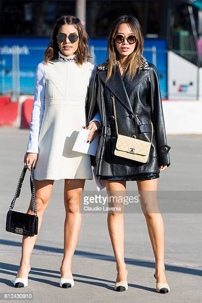 Aimee Song and guest attend Chanel show on day 8 of Paris Womens Fashion Week Spring/Summer 2017 on October 4 2016 in Paris France