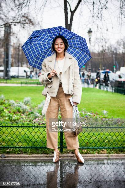 Aimee Song is seen in the streets of Paris after the Elie Saab show during Paris Fashion Week Womenswear Fall/Winter 2017/2018 on March 4 2017 in...