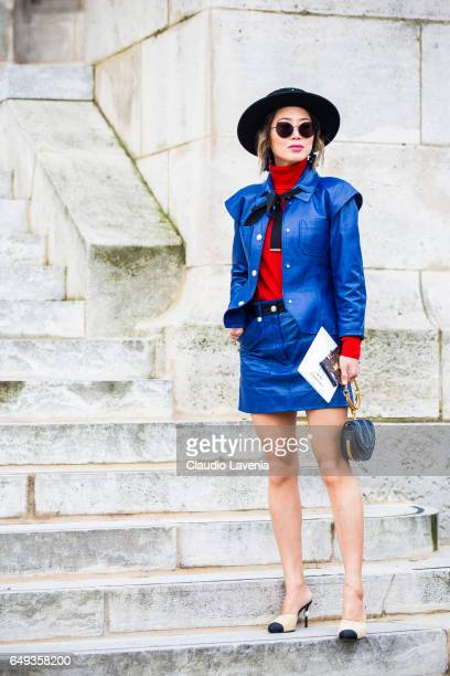 Aimee Song is seen in the streets of Paris before the Chanel show during Paris Fashion Week Womenswear Fall/Winter 2017/2018 on March 7 2017 in Paris...