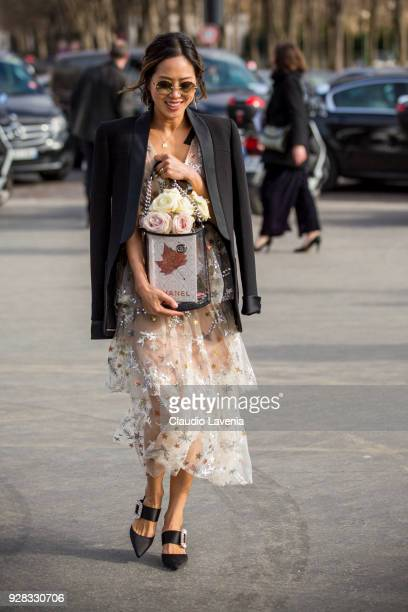 Aimee Song is seen in the streets of Paris before the Chanel show during Paris Fashion Week Womenswear Fall/Winter 2018/2019 on March 6 2018 in Paris...