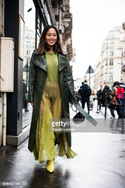 Aimee Song is seen in the streets of Paris before the Valentino show during Paris Fashion Week Womenswear Fall/Winter 2017/2018 on March 5 2017 in...