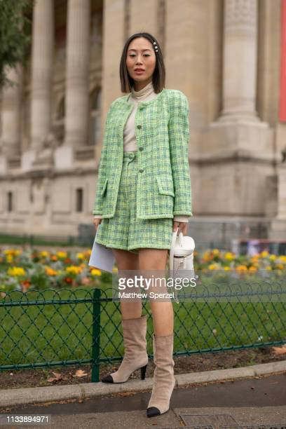 Aimee Song is seen on the street attending CHANEL during Paris Fashion Week AW19 wearing CHANEL green plaid outfit and white bucket bag on March 05...