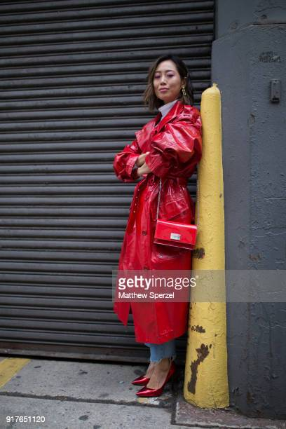 Aimee Song is seen on the street attending Ralph Lauren during New York Fashion Week wearing a red coat with red bag and shoes on February 12 2018 in...