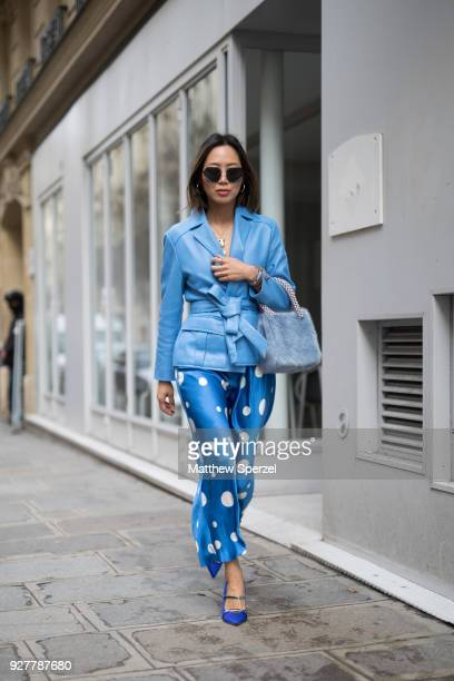 Aimee Song is seen on the street attending Sacai during Paris Women's Fashion Week A/W 2018 wearing an allblue outfit with polka dot pants on March 5...