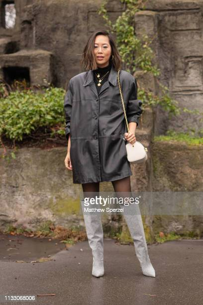 Aimee Song is seen on the street during Paris Fashion Week AW19 wearing BALMAIN on March 01 2019 in Paris France