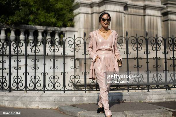Aimee Song is seen on the street during Paris Fashion Week SS19 wearing Balmain on September 28 2018 in Paris France