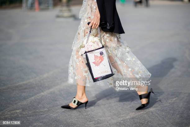 Aimee Song is seen outside Chanel wearing Chanel bag during Paris Fashion Week Womenswear Fall/Winter 2018/2019 on March 6 2018 in Paris France