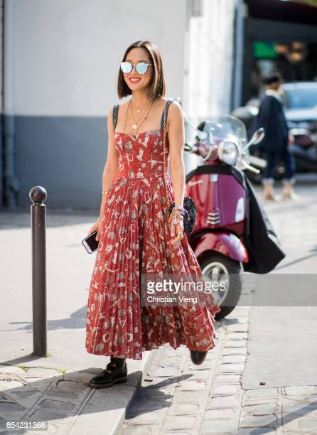 Aimee Song is seen outside Dior during Paris Fashion Week Spring/Summer 2018 on September 26 2017 in Paris France